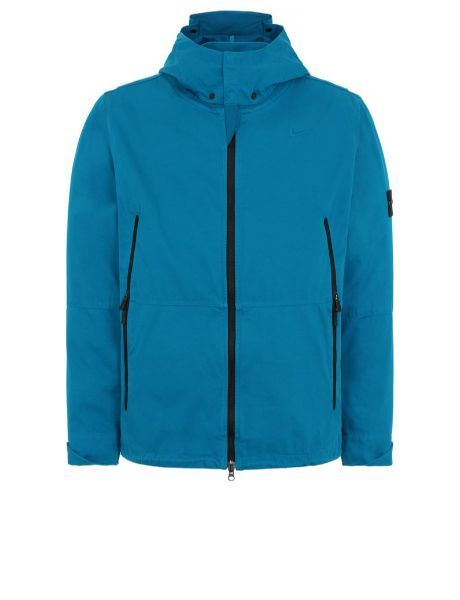 Front view of turquoise, performance jacket with hood, vertical, black zipper pockets and black zipper fastening.
