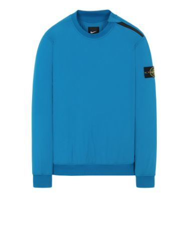 Front view of turquoise, performance crewneck with ribbed cuffs, neckline and bottom hem with Stone Island badge on left arm.