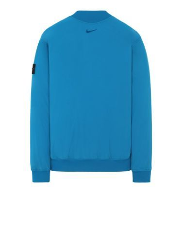 Back view of turquoise, performance crewneck with ribbed cuffs, neckline and bottom hem, with Nike logo below the neckline.