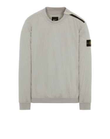 Front view of gray, performance crewneck with ribbed cuffs, neckline and bottom hem with Stone Island badge on left arm.