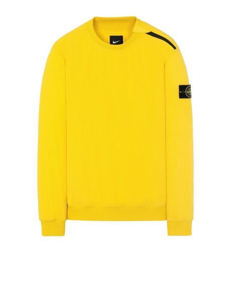 Front view of yellow, performance crewneck with ribbed cuffs, neckline and bottom hem with Stone Island badge on left arm.