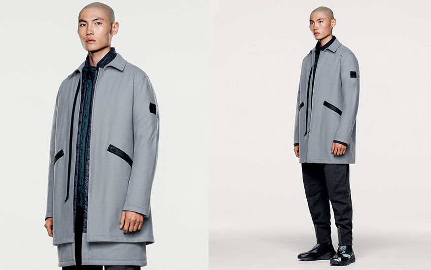 Two shots of model in gray, mid length jacket with black diagonal zipper pockets and black zipper fastening.