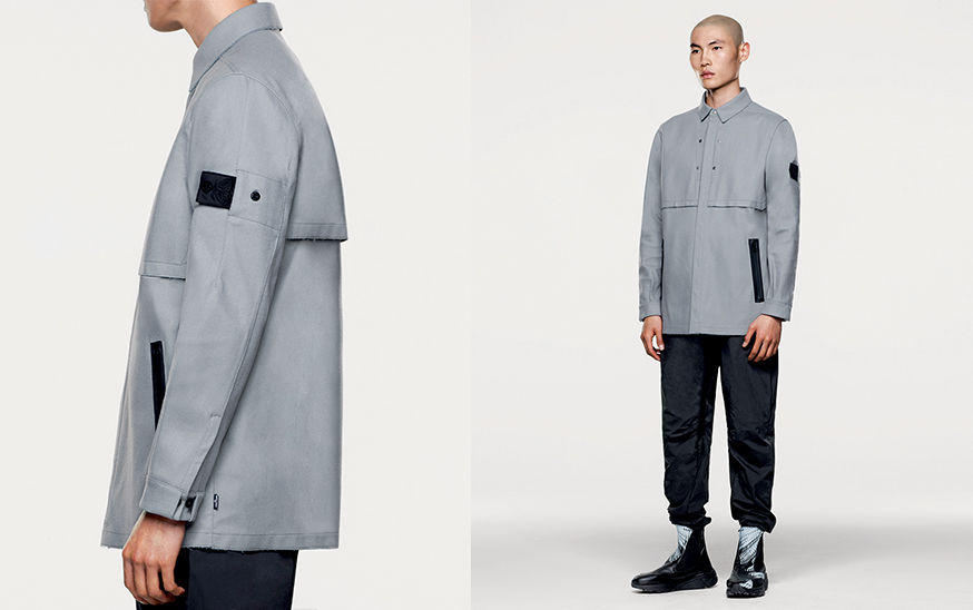 Side and front views of model in light gray jacket with diagonal, black welt pockets and Stone Island Shadow Project black Nylon badge.