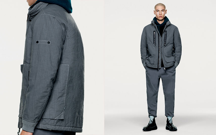 Side and front views of model in dark gray, quilted jacket and dark gray pants.