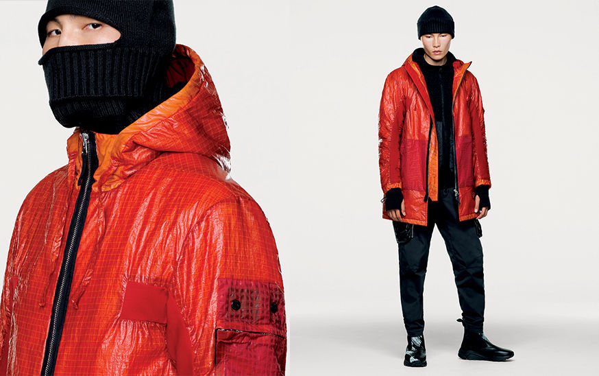 Side and front views of model wearing red, hooded jacket with black zipper fastening.