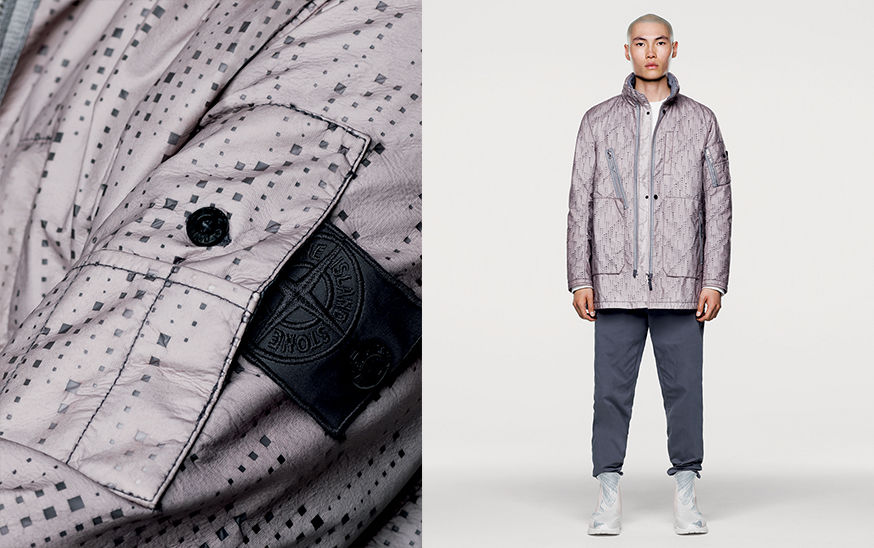 Model wearing pale lilac, mid length jacket with graphic square print and close up of Stone Island Shadow Project black Nylon badge.