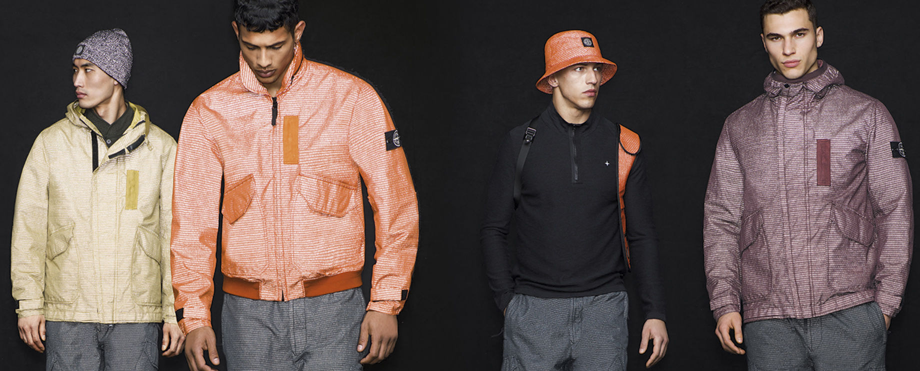 Four models on black background, three wearing different colors and styles of reflective jackets, the fourth wearing a reflective bucket hat.