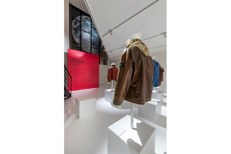 Close up of artistic installation with mannequins wearing Stone Island jackets in different styles and colors.