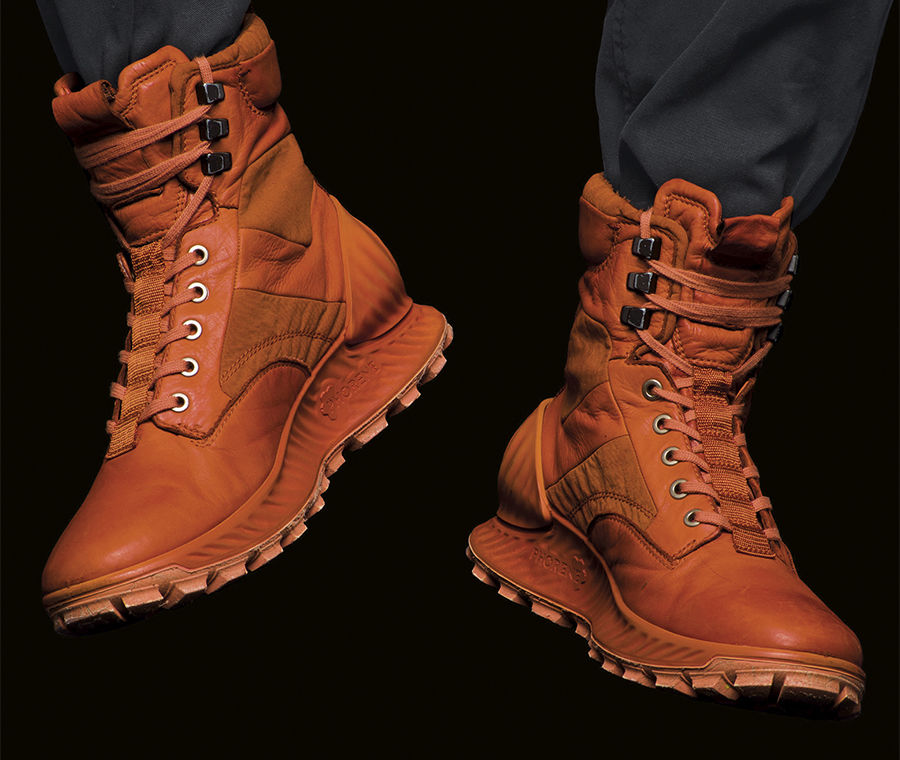 Rugged lace up ankle boots with tread soles in orange with monochrome laces