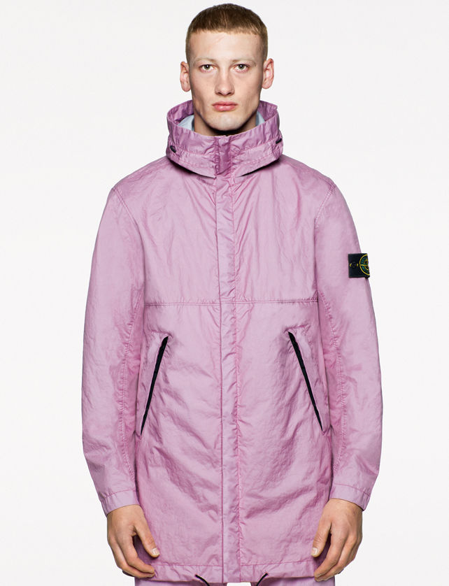 Model wearing a light mauve jacket with high collar, side pockets, black drawstring at the bottom, together with matching pants