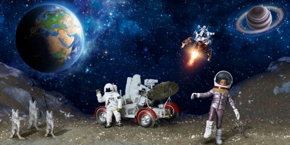 Space scene with two astronauts on a rover and a junior model wearing matching metallic jacket and pants, space boots and helmet.