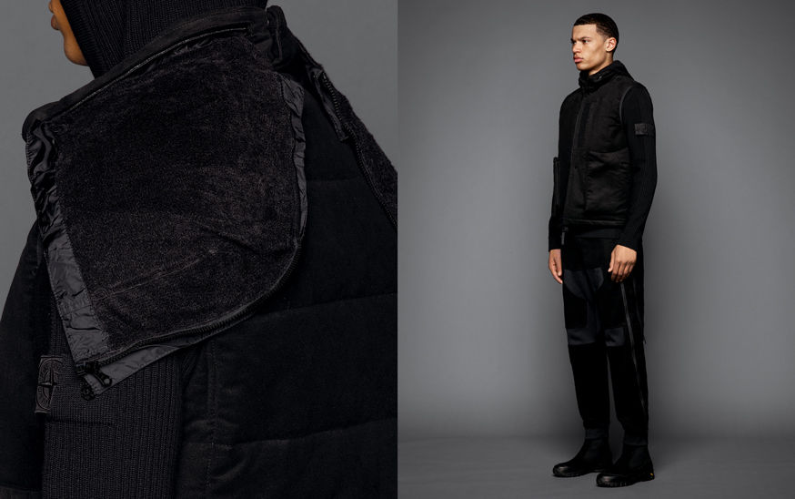 Two shots of the same model, one showing the detail of a black vest whose hood can be opened with a zipper down the middle, the other one with the model wearing black boots, black pants with patches in different materials, a black sweater and a black vest