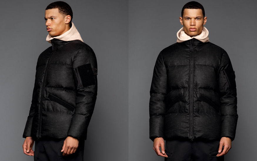 Two shots of the same model, from the front and side, wearing black pants, an off white hooded sweatshirt and a black down jacket with standing collar and zipper fastening.