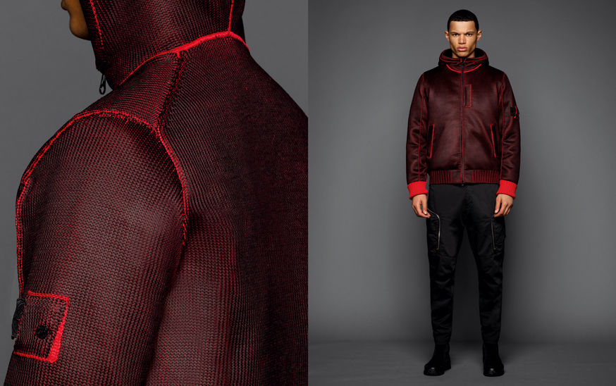 Two shots of the same model, one showing the shoulder area of a dark red woven jacket, the other one with the model wearing black boots, black cargo pants and a dark red woven jacket with hood, slanting hand pockets and red ribbed cuffs.