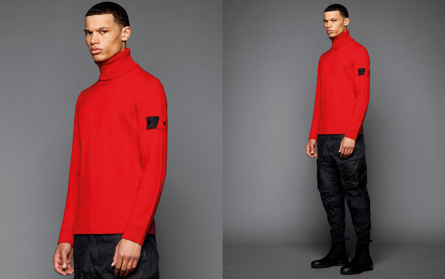 Two shots, one close up and one full body, of the same model wearing black boots, black cargo pants and a bright red turtleneck sweater.