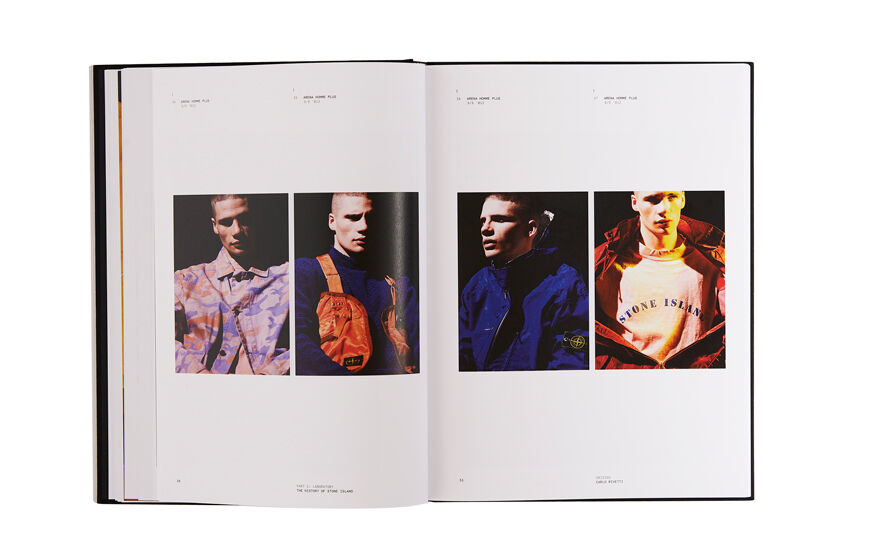 Still life image of an open hardcover book showing two pictures, each with a single model, on the left page and two pictures, each with a single model, on the right page.