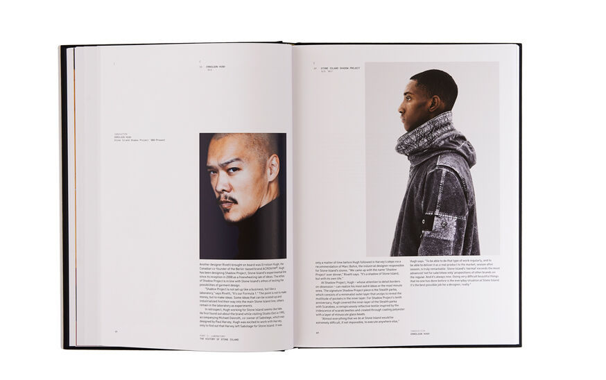 Still life image of an open hardcover book showing printed text and a close up shot of Errolson Hugh on the left page and printed text and a side shot of a model wearing a hooded jacket on the right page.