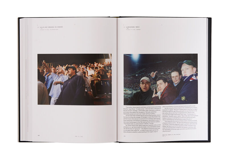 Still life image of an open hardcover book showing a picture of many people standing on a tribune on the left page and printed text and a picture of four men on the stands of a full stadium, wearing Stone Island jackets on the right page.