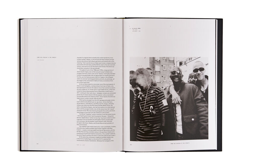 Still life image of an open hardcover book showing printed text on the left page and a black and white image of six men on the right page.