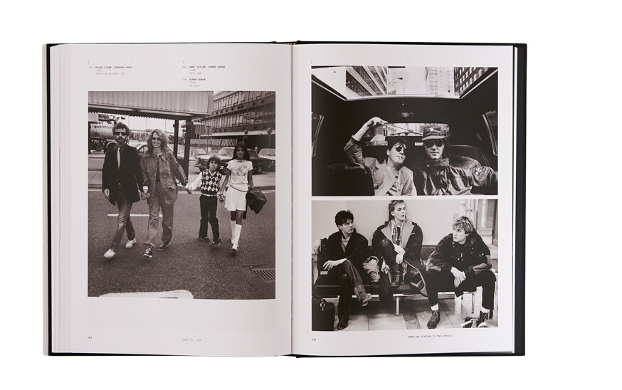 Still life image of an open hardcover book showing black and white pictures of people wearing Stone Island garments, one full page on the left and two pictures on the right page.