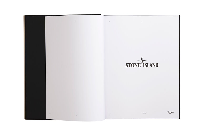 Still life image of an open hardcover book showing a fully white left page and the Stone Island logo in black on the right page.
