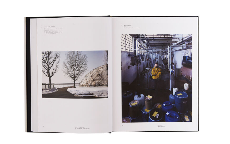 Still life image of an open hardcover book showing a picture of a modern dome surrounded by snow and two trees on the left page and a man wearing a yellow jacket inside a factory on the right page.