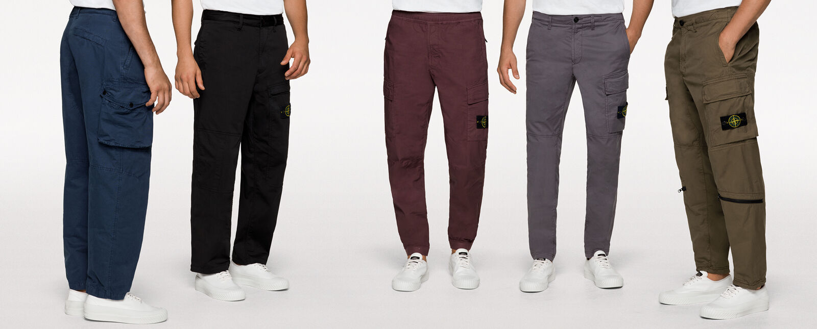 Close up shots of five models wearing white tops, white sneakers and different styles cargo pants in blue, black, burgundy, gray and military green.