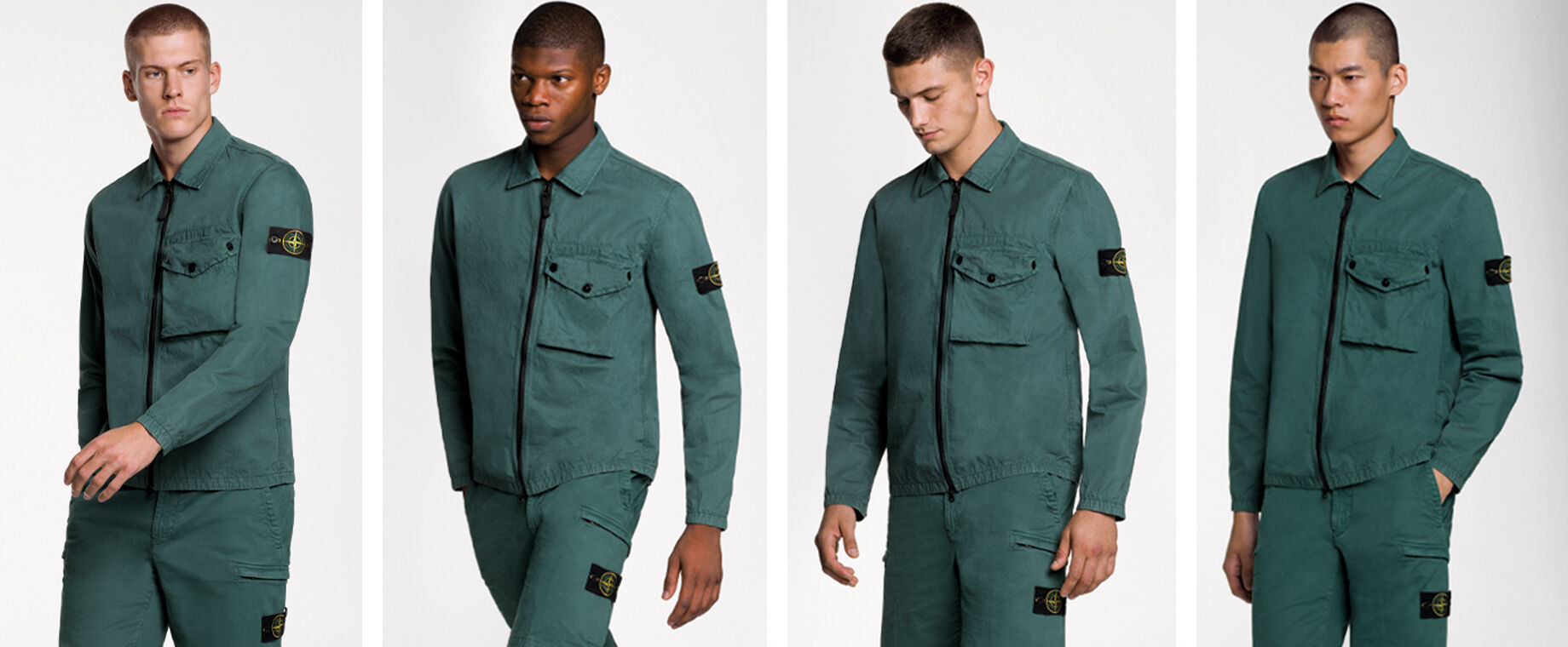 Four models wearing the same outfit, consisting of dark green shorts and a matching overshirt with two way zipper fastening, a bellows pocket with flap and snaps on the chest and the Stone Island badge on the upper left arm.