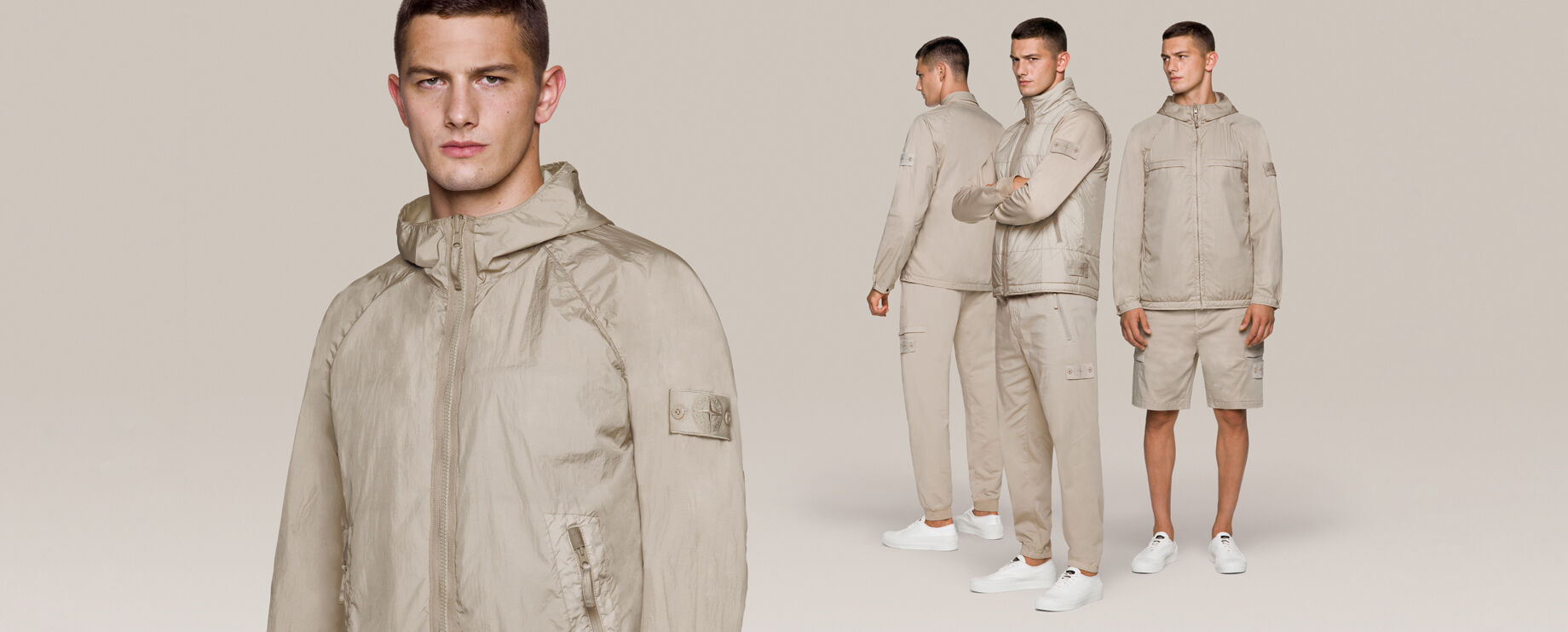 Four shots of the same model wearing monochromatic beige outfits with different styles of cargo pants, shorts and jackets, all with the Stone Island ghost badge.