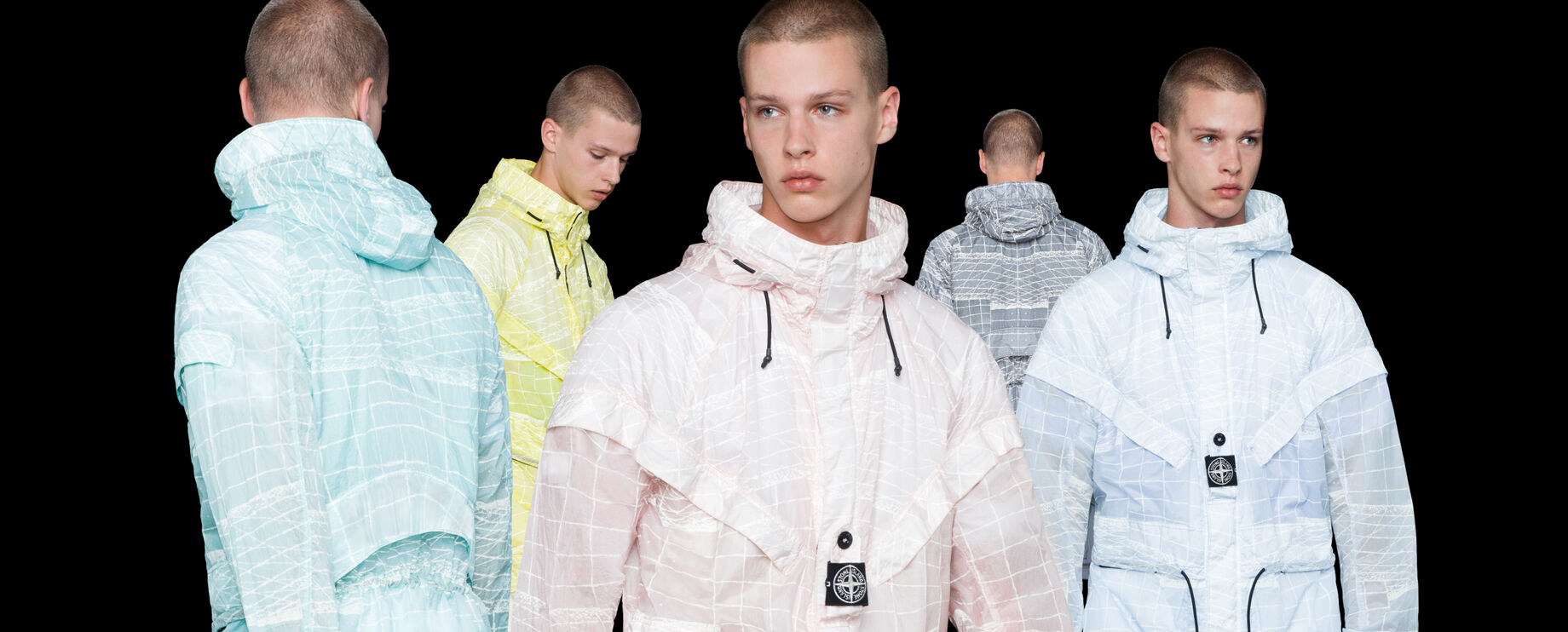 Five shots of the same model showing the front, side and back of a hooded jacket in different colors, aqua blue, yellow, light pink, gray and light blue, all with a white print.