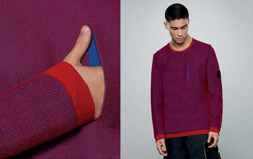 Two shots of the same model, one super close up of the weave and one close up, wearing a red and blue crewneck sweater with one standing pocket on the chest and the Stone Island Shadow Project badge on the upper left sleeve.