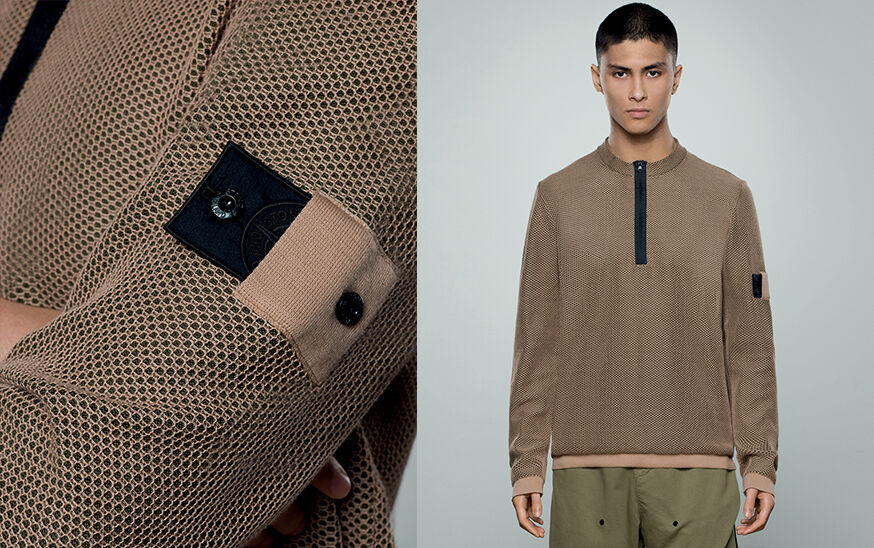 Two shots of the same model, one super close up of Stone Island Shadow Project badge and one close up, wearing khaki pants and a beige crewneck sweater with black half zipper fastening.