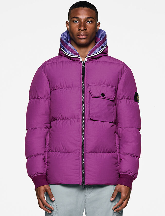 Model wearing off white cargo pants and a violet down jacket with two way zipper fastening, a hood with blue and violet print lining, one chest pocket with flap and snap and elasticated cuffs.