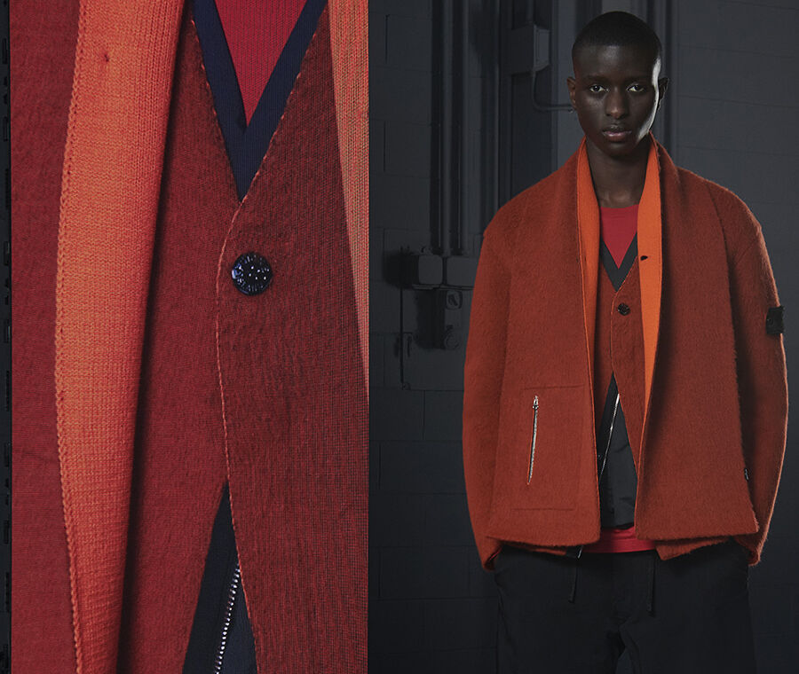 Model wearing a red and blue sweater under a two-tone orange coat, fastened by one button, beside an extreme close-up of the button.